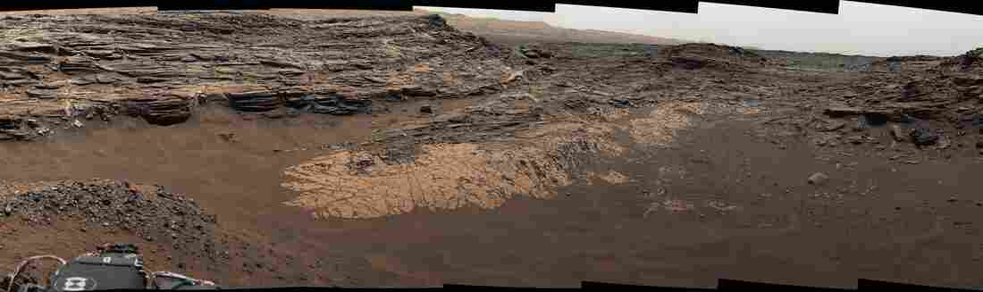 "NASA's Curiosity Mars rover captured this composite view of the ""Marias Pass"" area, showing layers of mudstone and sandstone. The rover found high levels of silica, as well as a rare mineral it had never seen on Mars: tridymite."