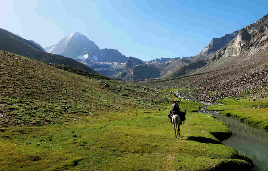 A Panjshiri guide rides through one of the valleys leading to Mir Samir, one of Afghanistan's most challenging peaks, near which the Afghan women and girls set up base camp for their climbing expedition.