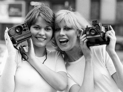 Do you and your friends look like these British models from the 1970s? If not, have no fear — you can still capture memories (digitally) in a shared private photo collection. (Manchester Daily Express/SSPL/Getty)