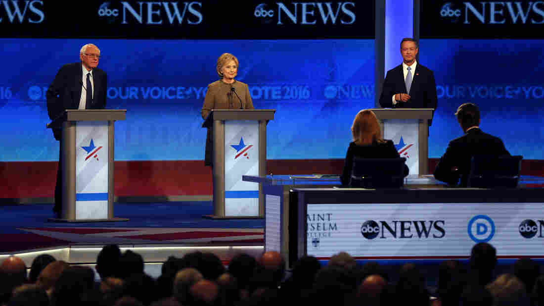 Bernie Sanders, Hillary Clinton, center, and Martin O'Malley on stage at the Democratic presidential primary debate Saturday at Saint Anselm College in Manchester, N.H.