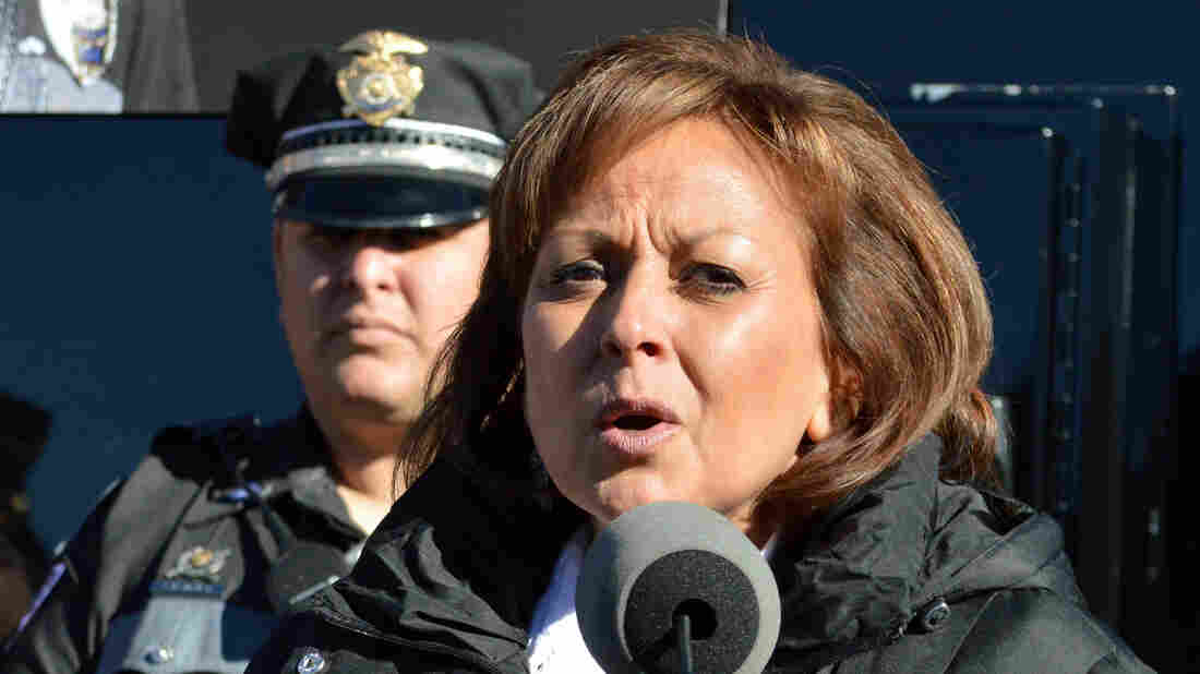 New Mexico Gov. Susana Martinez, seen here speaking Monday, has apologized for her handling of complaints against her hotel room after a staff holiday party in Santa Fe.