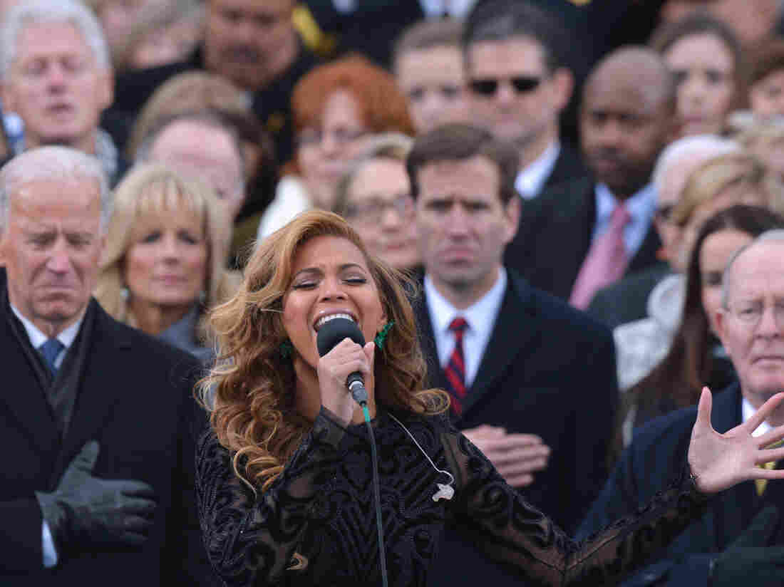 Beyonce performs the National Anthem as then-U.S. Sec. of State Hillary Clinton looks on in the background at the ceremonial swearing-in of President Obama in 2013.