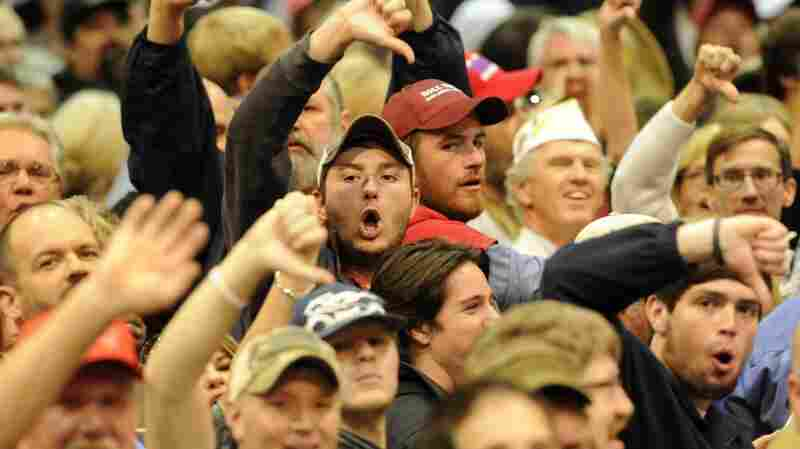 At a November rally in Birmingham, Ala., Trump supporters boo the media after a heckler was removed from the event.