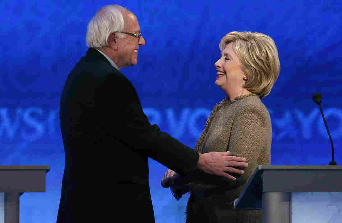 Bernie Sanders speaks with Hillary Clinton during a break at the third Democratic presidential debate Saturday night at Saint Anselm College in Manchester, N.H.