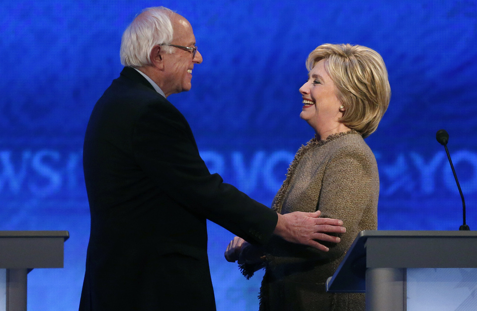 Bernie Sanders speaks with Hillary Clinton during a break at the third Democratic presidential debate Saturday night at Saint Anselm College in Manchester, N.H. (Jim Cole/AP)