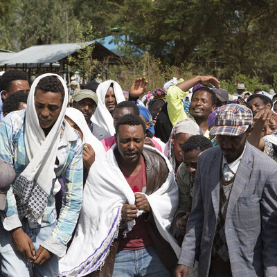 People mourn the death of Dinka Chala who was shot dead by the Ethiopian forces the day earlier, in the Yubdo Village, about 100 km from Addis Ababa in the Oromia region, on Dec. 17, 2015.