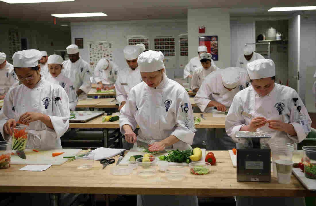 Students prep vegetables at the California Culinary Academy in April 2009 in San Francisco, Calif. The Le Cordon Bleu affiliate is among 16 schools due to close after graduating their final classes due to start in January.