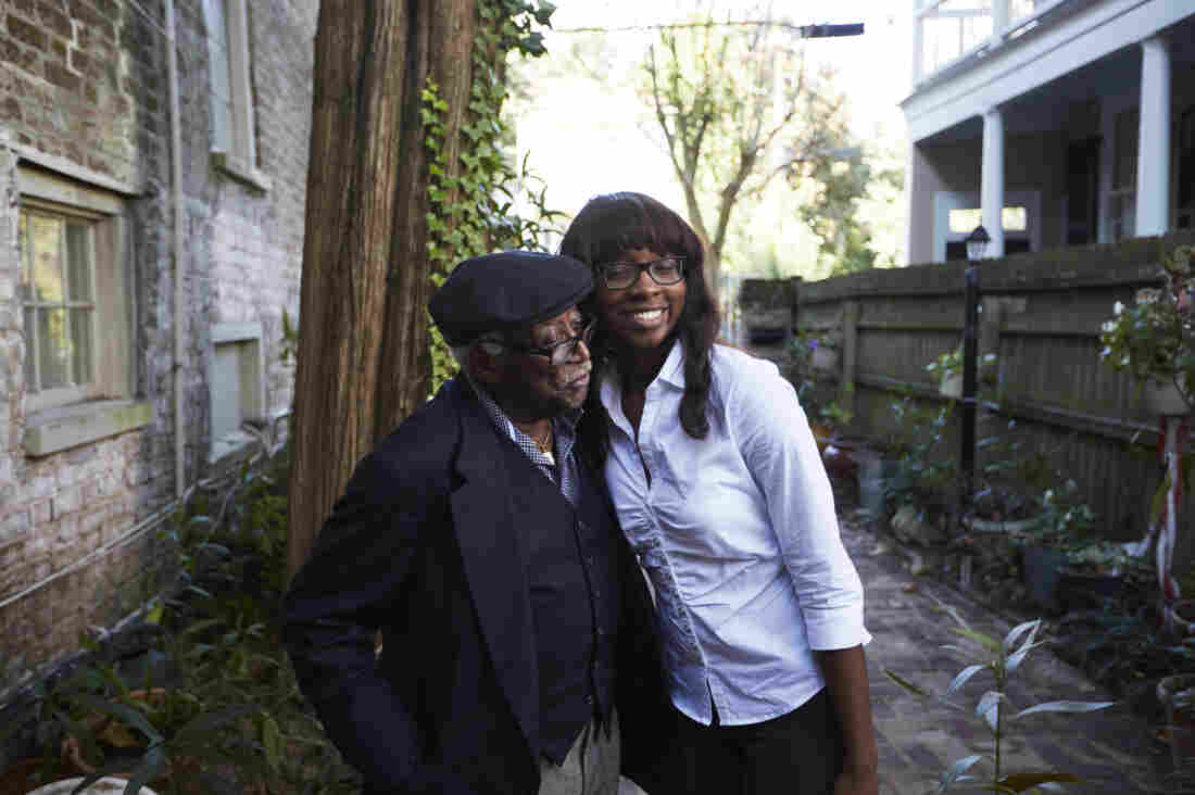"""Judge Richard Fields, affectionately known as """"The Judge"""" to his family, and LaCurtia Brown embrace outside of Liz and Albert Alston's home."""