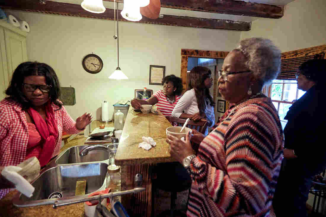 After more than an hour of political talk, Liz invited the family into the kitchen for some sweet ice tea, red rice, and collard greens.
