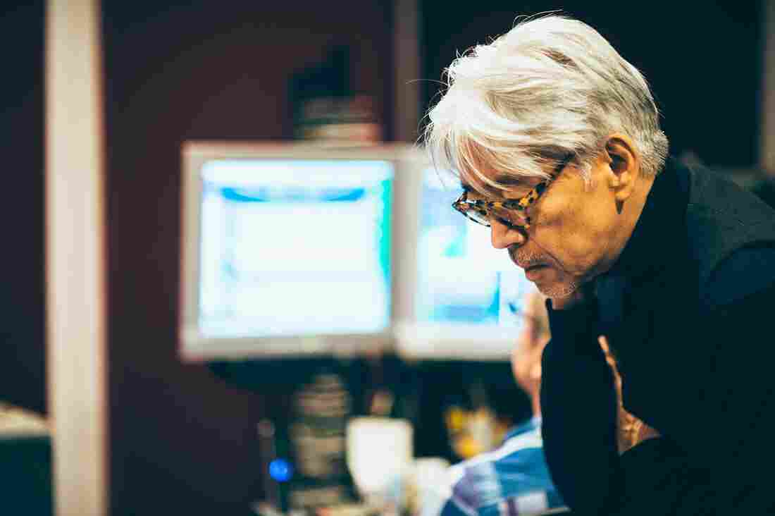 Ryuichi Sakamoto at work in the studio.