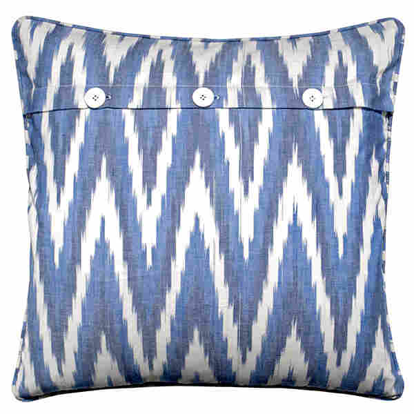 Ikat pillow by Mela Artisans. The yarn is dyed first, then woven, creating bold, zigzag patterns.