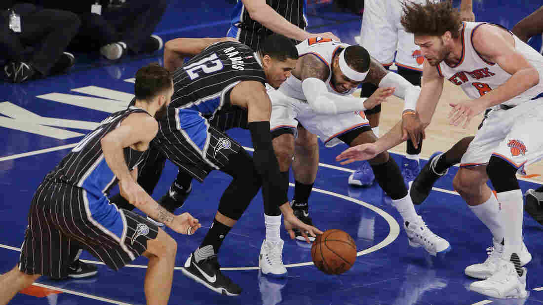 New York Knicks forward Carmelo Anthony is stripped of the ball by Orlando Magic forward Tobias Harris (second from left) as New York Knicks center Robin Lopez (far right) reaches in during the fourth quarter of their game Monday in New York.