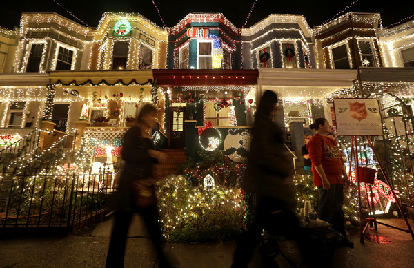 """Onlookers come to admire the self-proclaimed """"Miracle on 34th Street"""" in the Baltimore neighborhood of Hampden. But not every country has as much electricity as America does."""