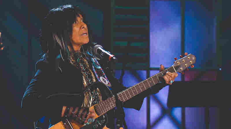 "Buffy Saint-Marie performs her song ""Universal Soldier"" at the 2015 Americana Music Awards."