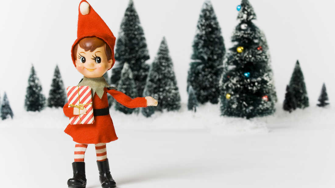 A toy elf in the woods.