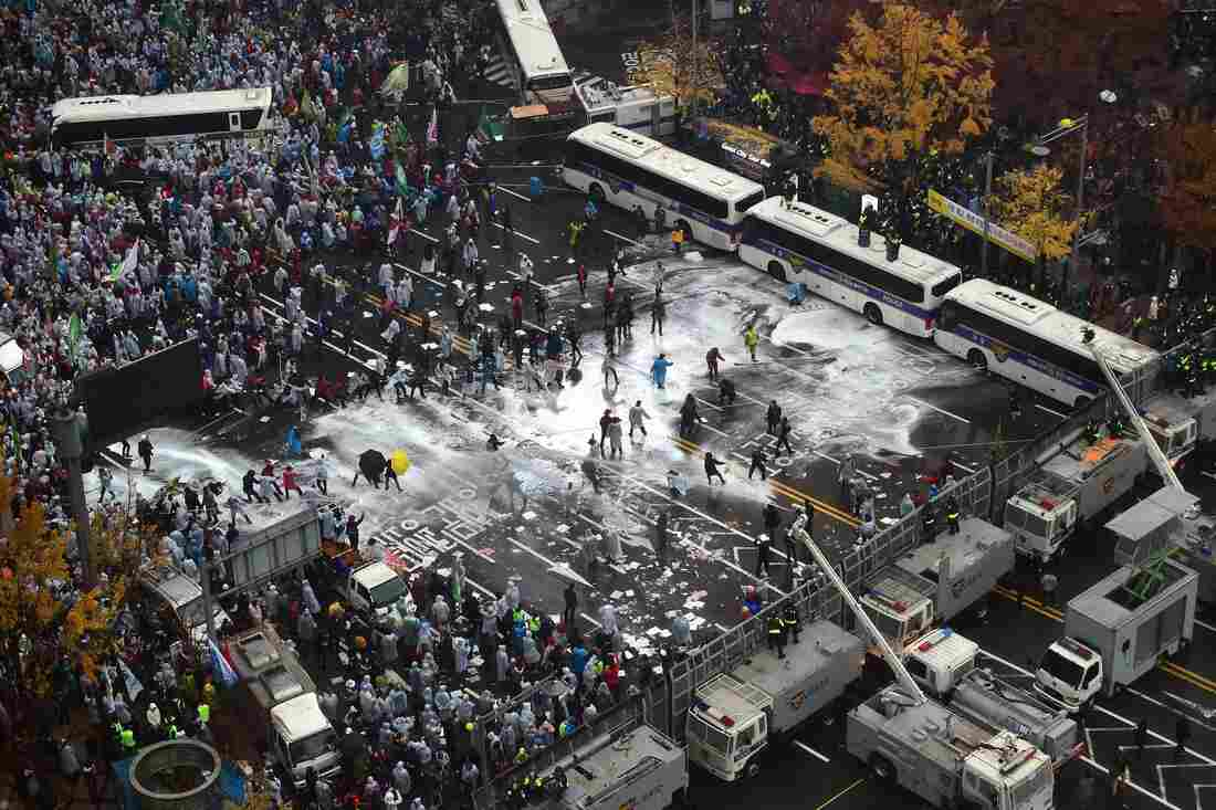 Police use water cannons to block South Korean protesters following a large rally against the government in downtown Seoul on Nov. 14.