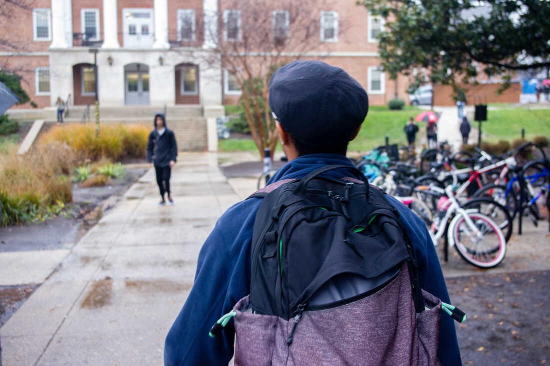 Rhys Hall, a senior at UMD, walks on the school's College Park campus.