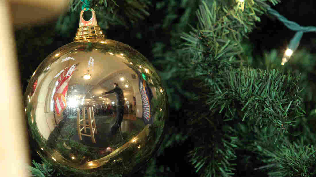 Republican presidential candidate Sen. Marco Rubio, R-Fla., reflected in a Christmas tree ornament during a campaign stop in New Hampshire.