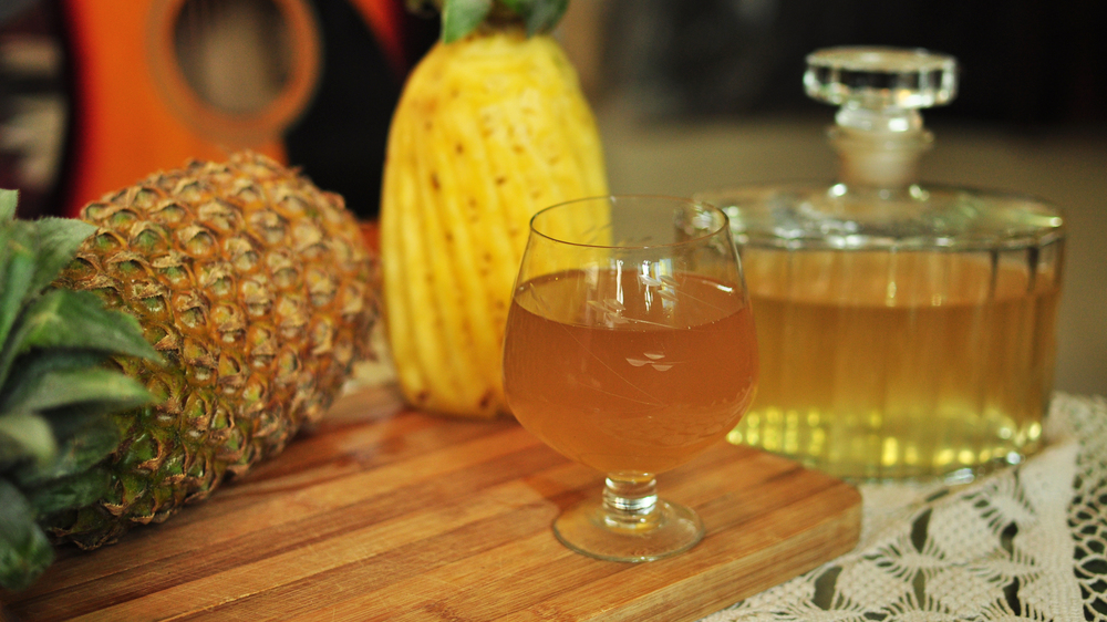 Across India, several Christian communities prepare sweet homemade wines for the festive season from a rich array of local fruit, roots and grain. Above, a glass of golden pineapple wine.