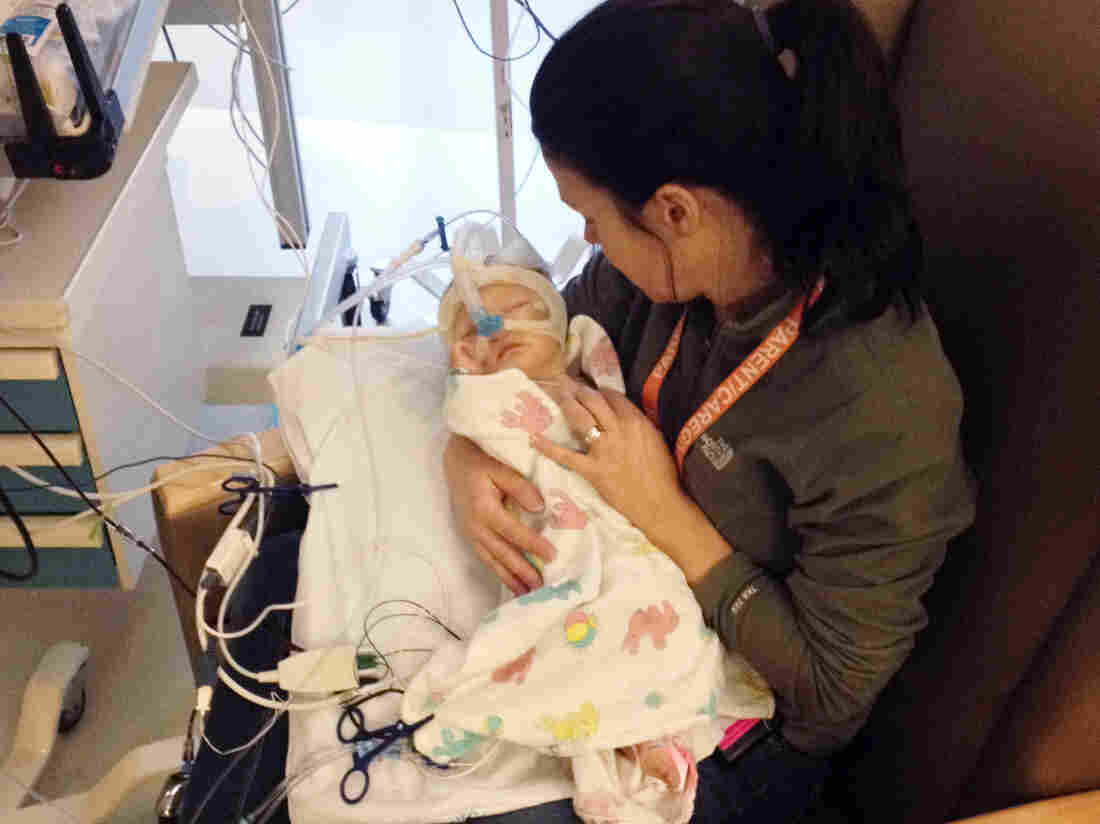 Amy Thompson holds 2-month-old Isla in Seattle Children's Hospital in early 2014. When the Thompson family learned Isla's heart was failing, they took an air ambulance from Butte, Mont., to Seattle to get medical care.