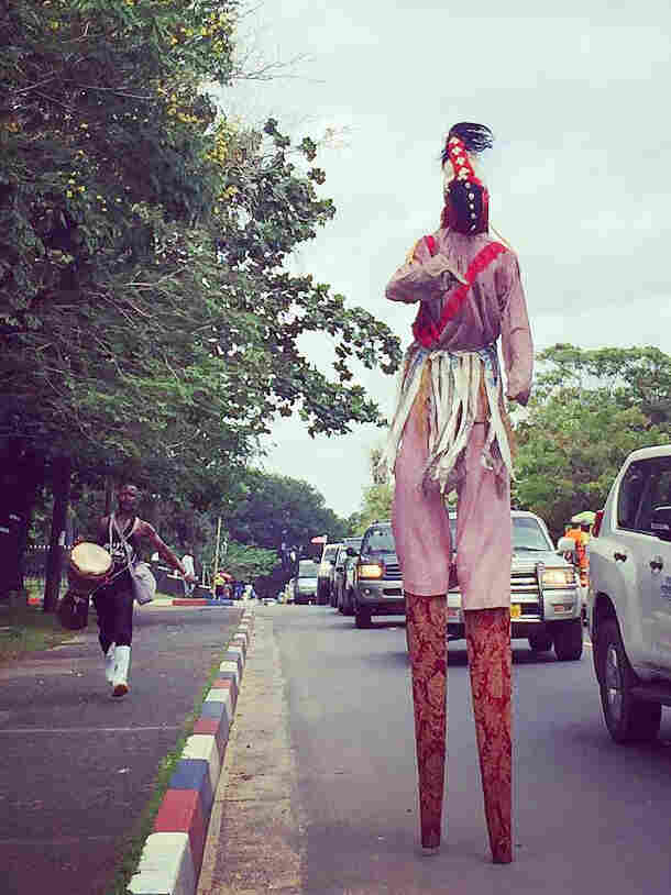 A country devil from the Gio tribal group walks through a neighborhood in Monrovia, Liberia's capital, as part of the pre-independence day celebration.