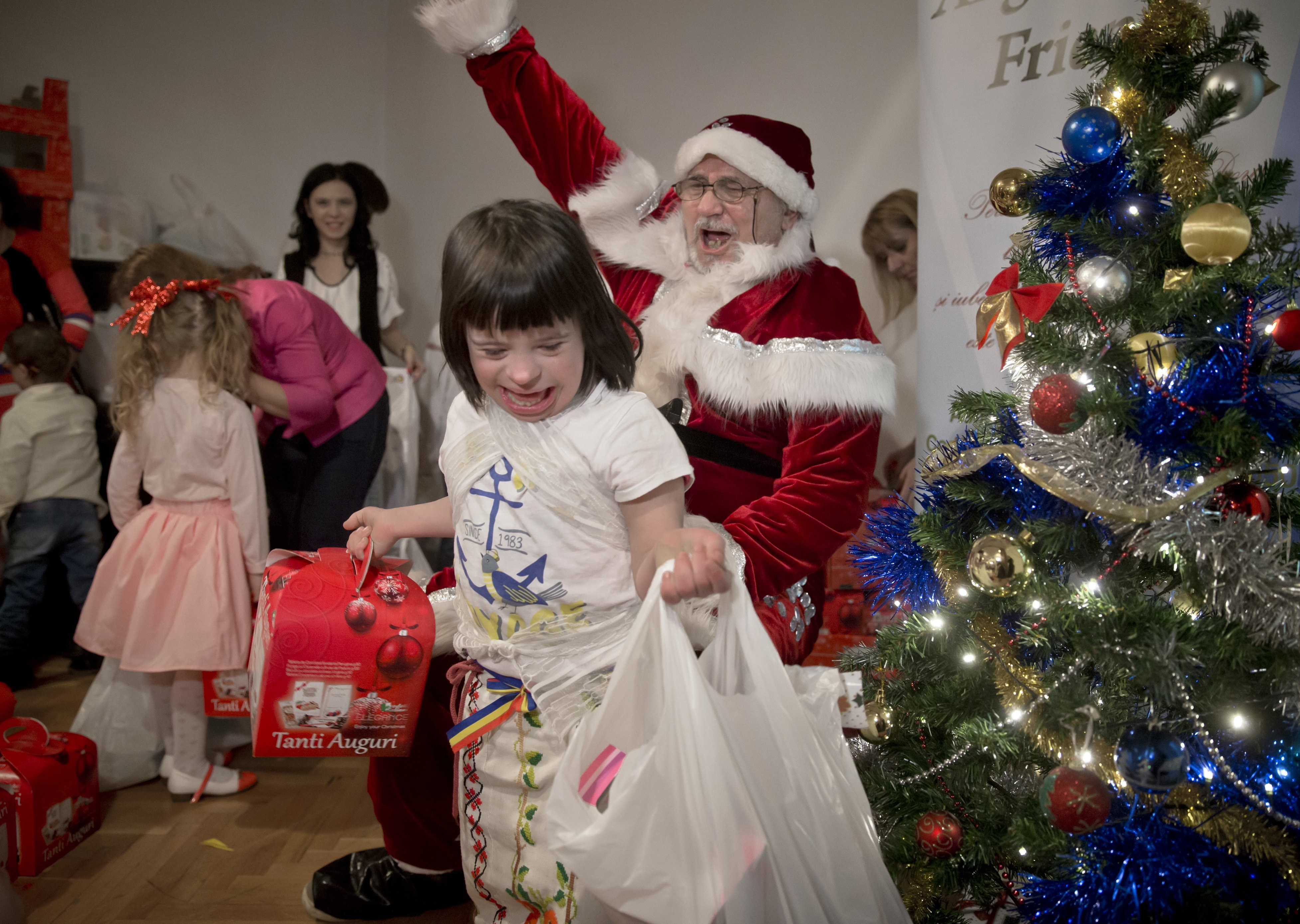 PHOTOS: In Romania, Santa Steps In To Help Fight Stigma Of Down Syndrome