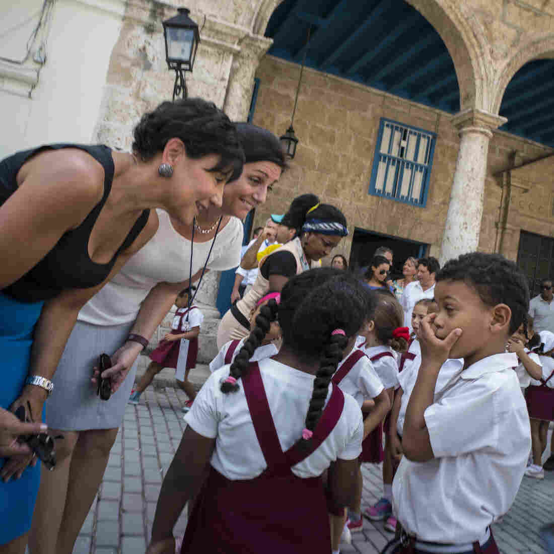 U.S. Commerce Secretary Penny Pritzker (left)talks with students in Havana in October. Pritzker led a delegation of U.S. officials who met their Cuban counterparts and businessmen to explore expanding ties. While restrictions are being removed, increased business links between the countries are limited so far.