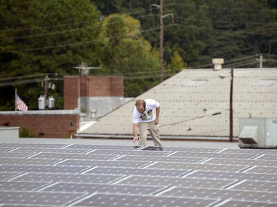 Mike Easterwood checks one of the solar panels installed on the roof of his self-storage business in Decatur, Ga., in 2013. The state has begun to embrace solar but it represents a fraction of the state's power generation.