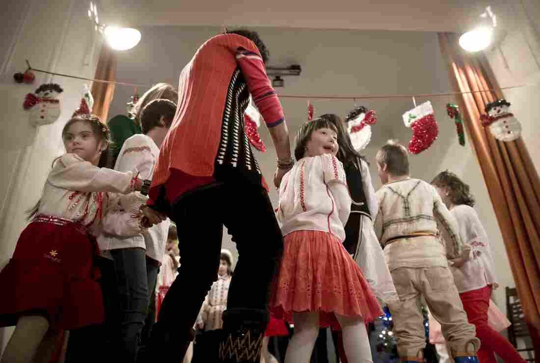 Children dance during the Dec. 18 event in Bucharest, Romania.