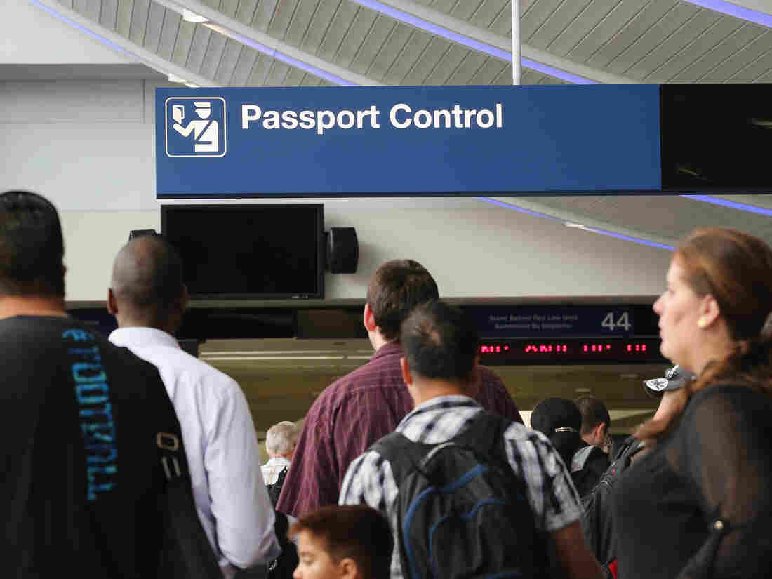 International travelers wait to have their passports checked at Chicago's O'Hare International Airport last year.
