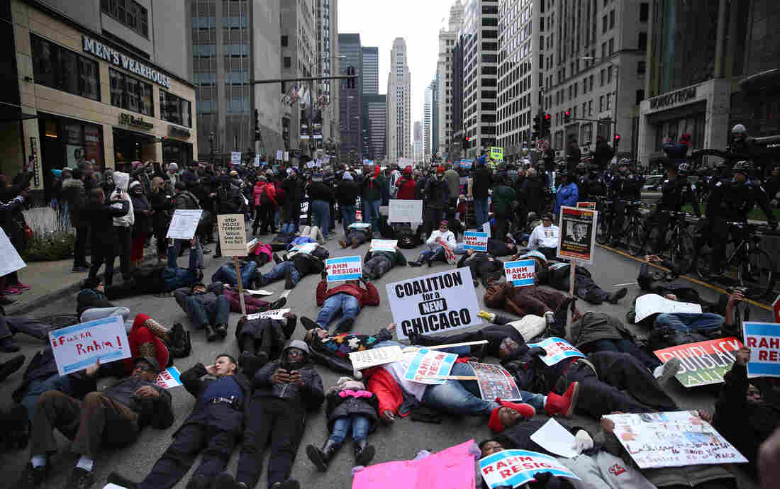 """People participate in what organizers are calling a """"Black Christmas"""" protest on Michigan Avenue in downtown Chicago Thursday."""