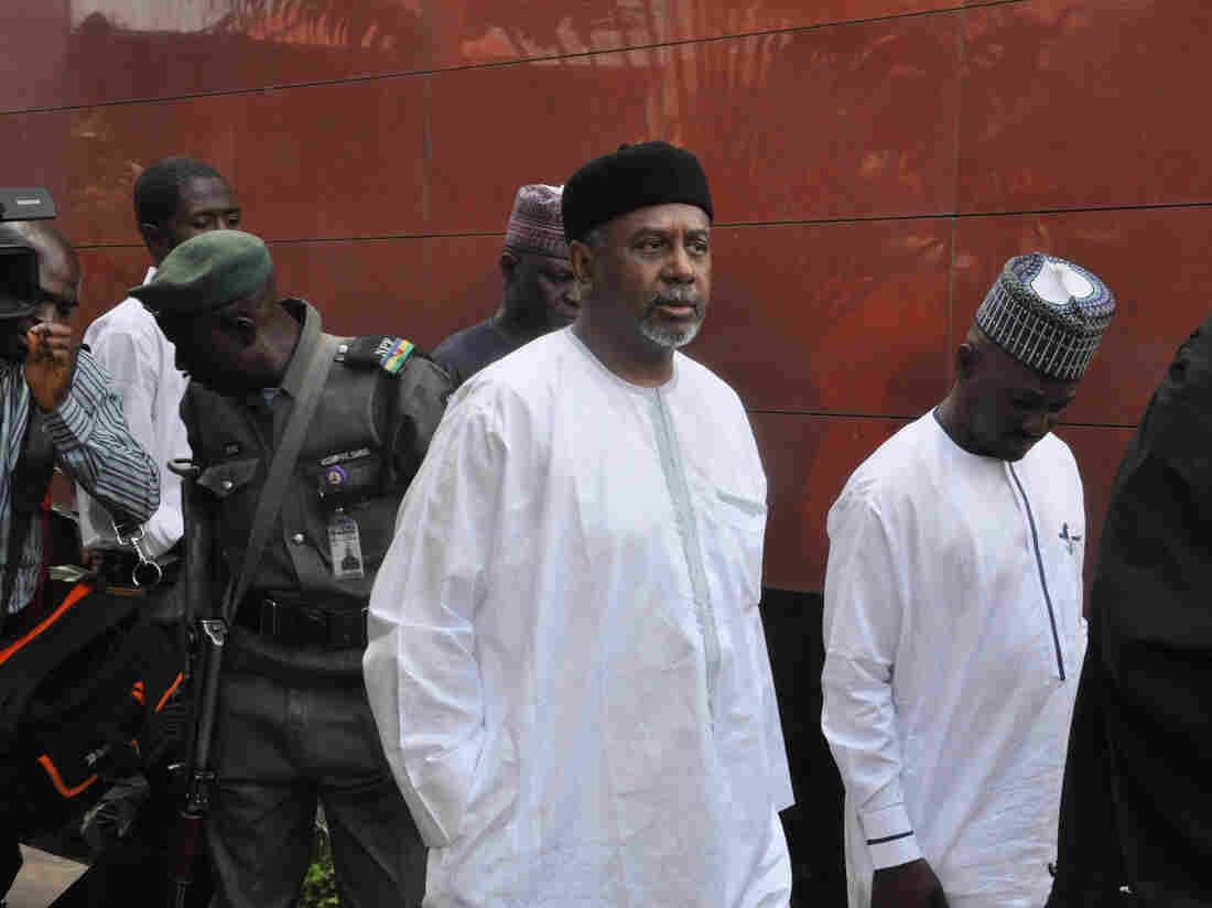 Nigeria's former national security adviser Sambo Dasuki (center) arrives at the Federal High Court in Abuja on Dec. 14 for a hearing on charges of possessing weapons illegally.