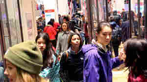 Shoppers walk out of Uniqlo on Fifth Avenue in New York City on Black Friday, Nov. 27.