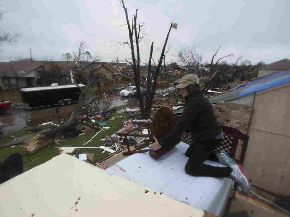 Delores Downard salvages items from her son's house in Rowlett, Texas on Sunday, the morning after it was struck by a tornado.