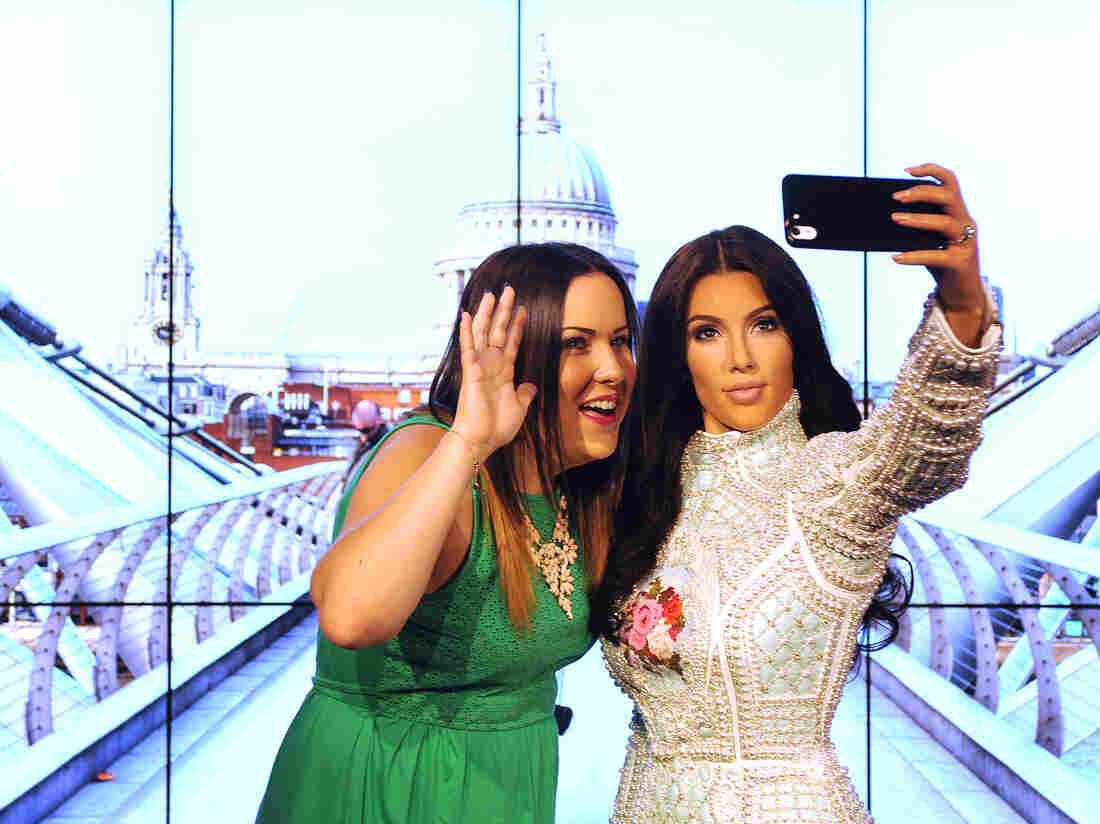 Art imitates life in this 2015 addition to London's Madame Tussauds: a wax figure of Kim Kardashian, taking a selfie — naturally.