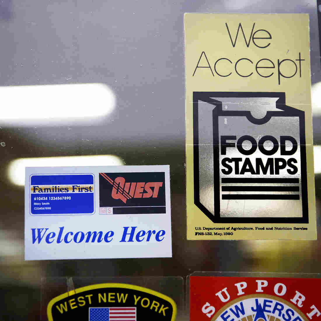 A supermarket displays stickers indicating it accepts food stamps in West New York, N.J., in January 2015.