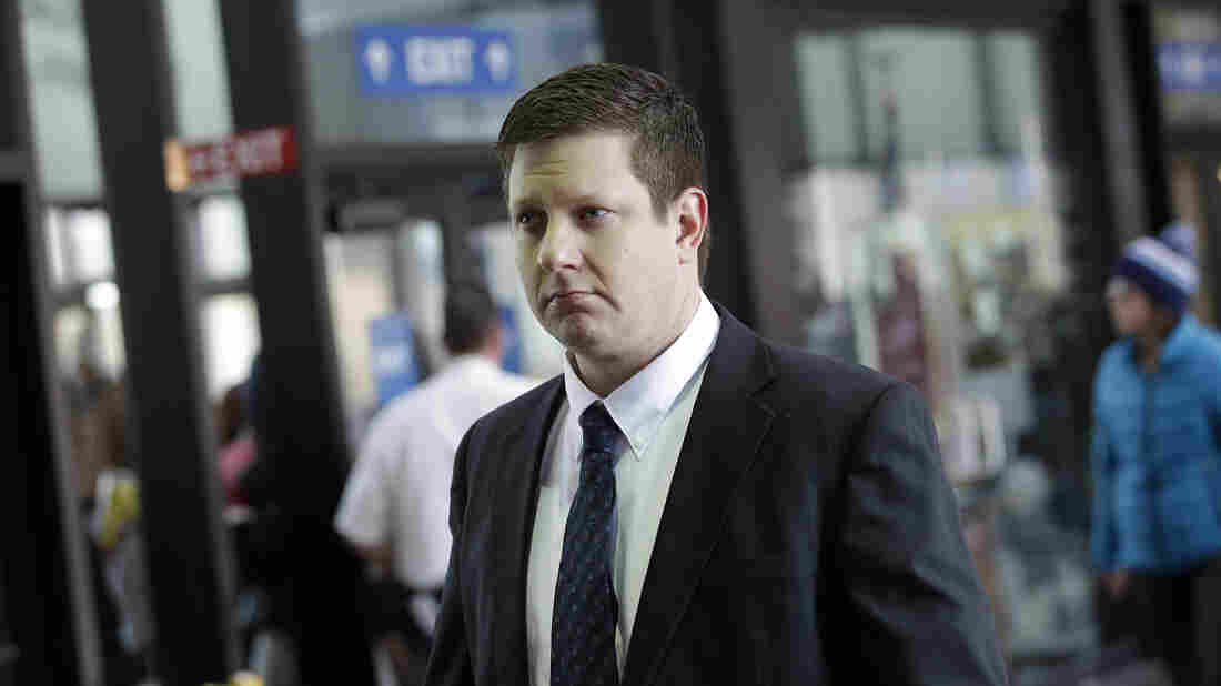 Chicago police Officer Jason Van Dyke, who was charged with murder last month in the shooting death of Laquan McDonald, arrives at the Cook County Criminal Court for a status hearing on Dec. 18.