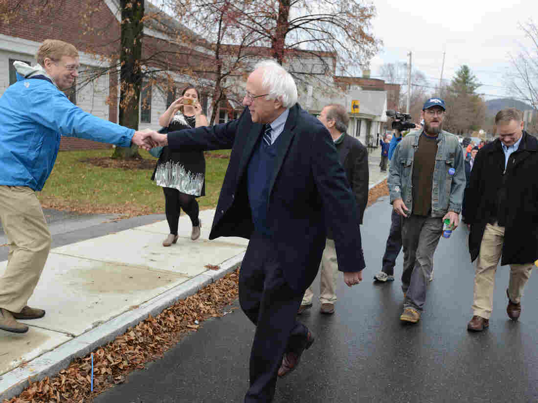 Presidential candidate Bernie Sanders shakes hands with people as he marches in the Veterans Day parade last month in Lebanon, N.H.