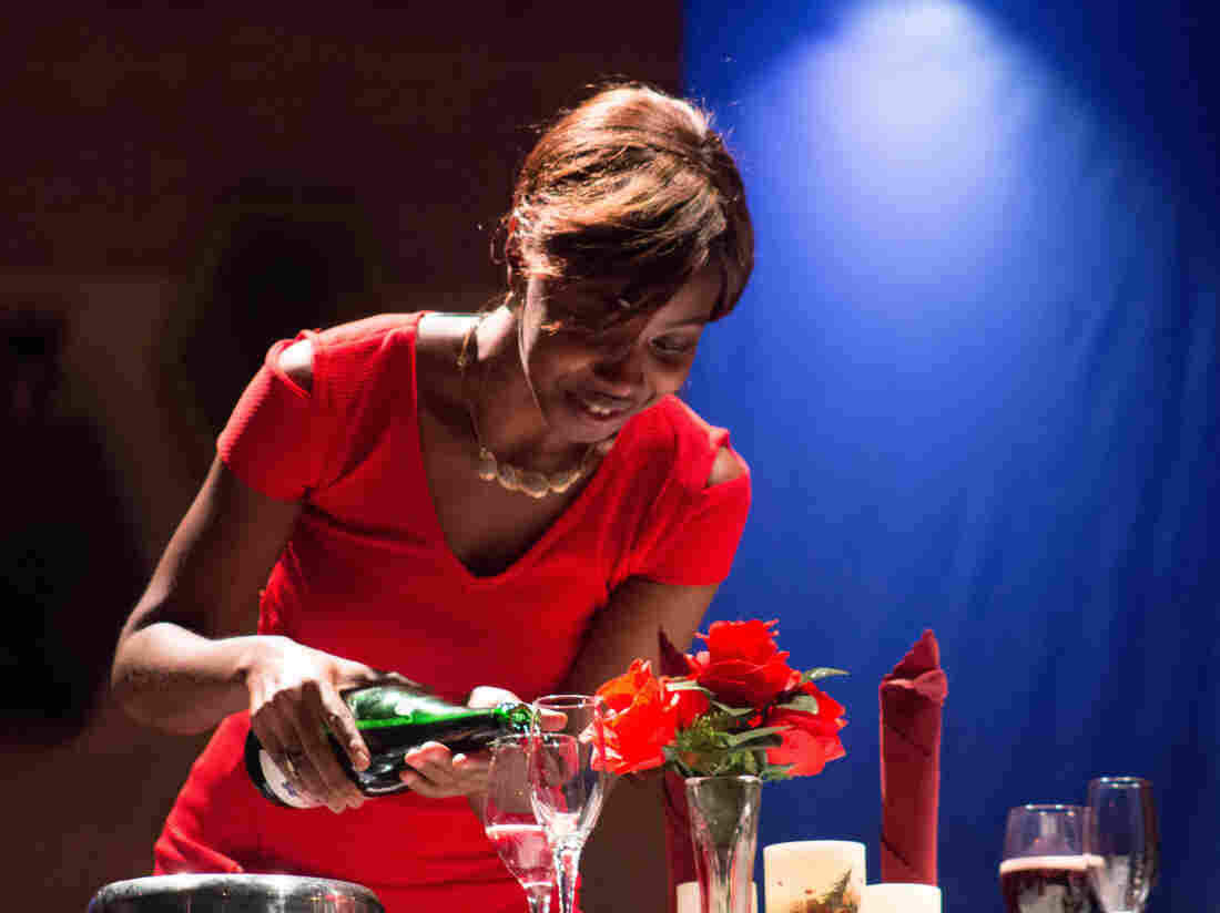 Ade, played by Nana Sam Elliott-Sackeyfio glows in new love at a private dinner, in the production of Bananas and Groundnuts.