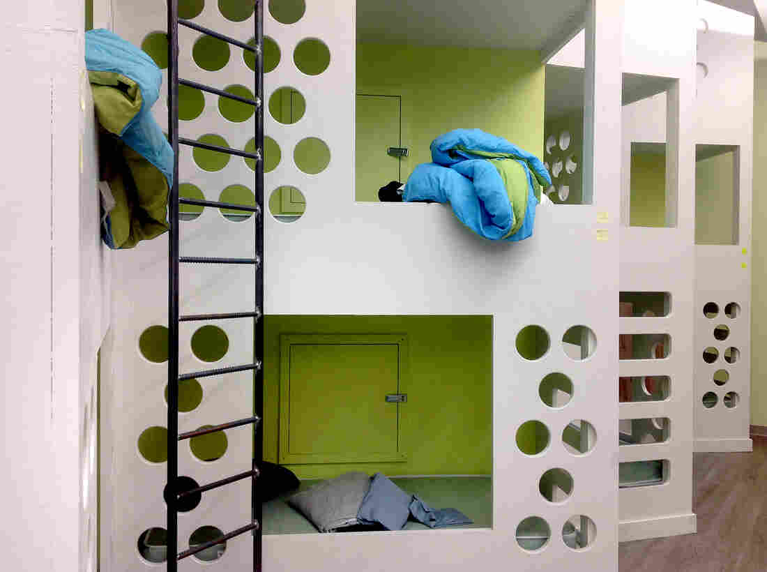 The 22 beds for young adults at the Y2Y shelter interlock like a giant treehouse.
