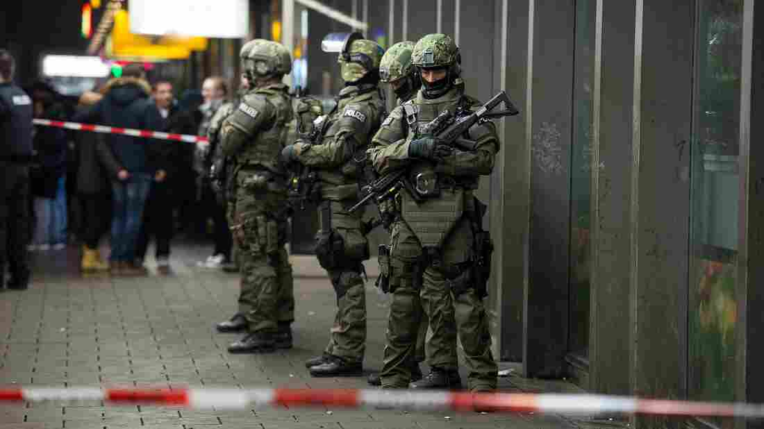 Armed German police on duty at the main railway station in central Munich on New Year's Eve.