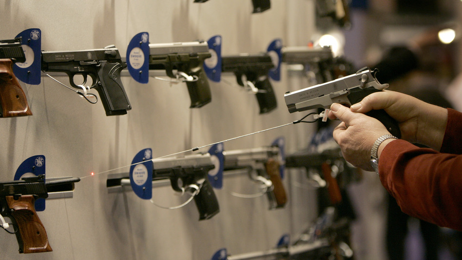 A federal rule requiring background checks doesn't apply to some of those doing business online and at gun shows, like this one put on by the National Rifle Association in April in St. Louis. Changing that exception is one idea that has been floated to the president. (Jeff Roberson/AP)