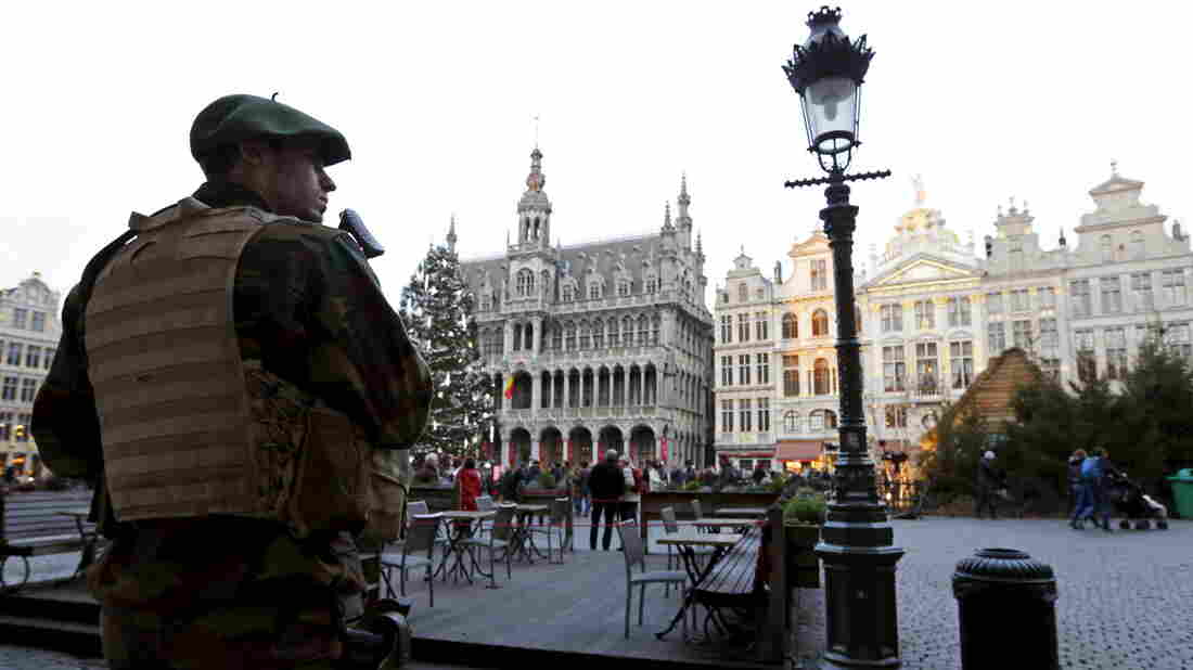 A Belgian soldier patrols Brussels' Grand Place after police say they disrupted a plot to attack during New Year's Eve celebrations in Belgium.