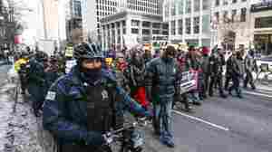 Chicago police escort protesters demonstrating against police brutality and gun violence in Chicago on Thursday.