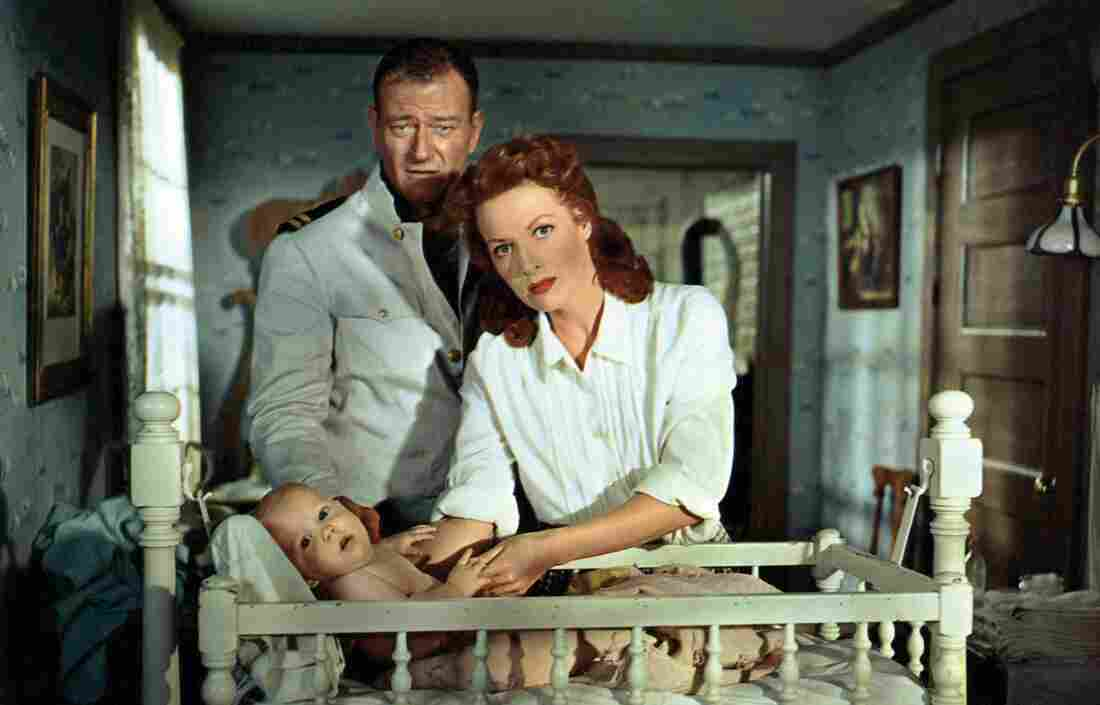 John Wayne and Irish-born American actress Maureen O'Hara looking after a child in The Wings of Eagles, from 1957. O'Hara died in 2015.