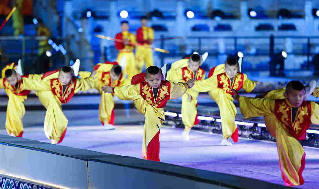 Children perform during the New Year's Eve countdown to 2016 at the Ancestral Temple in Beijing.