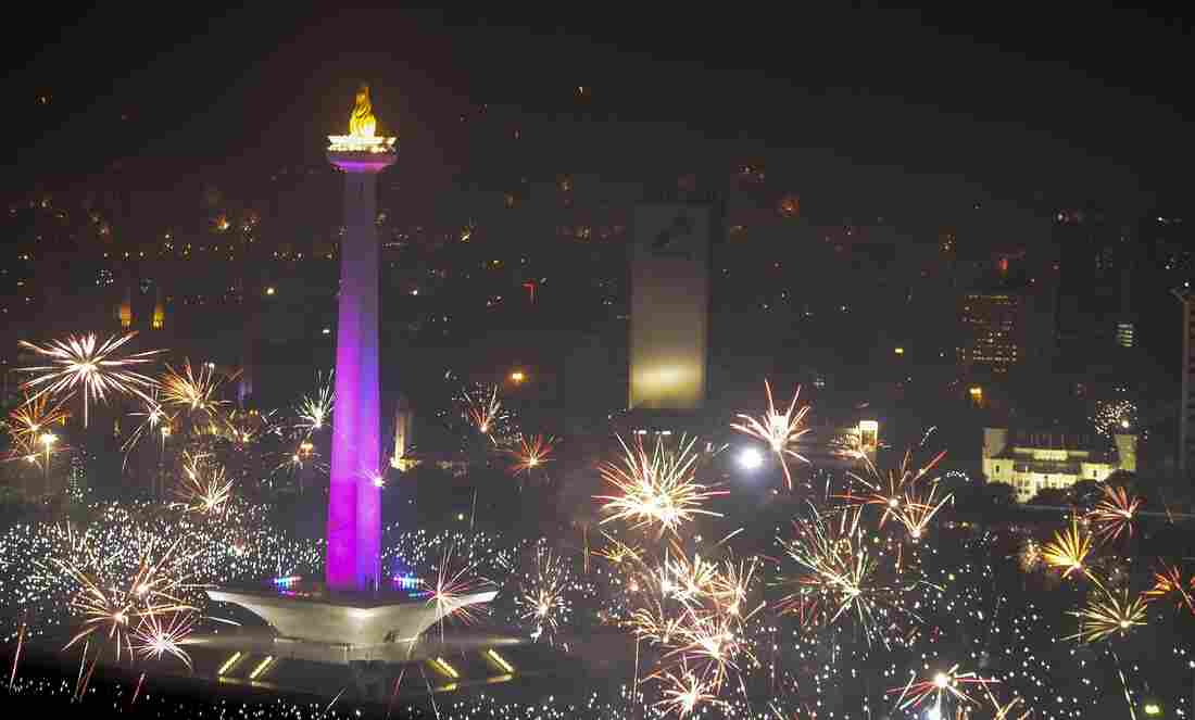 Fireworks explode over the National Monument (Monas) in Jakarta, Indonesia.