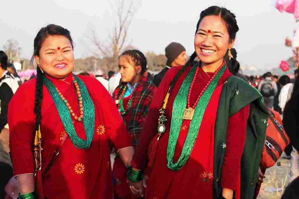 Anusha Gurung (left) and her friend Illa Gurung take part in a New Year's dance competition in Kathmandu, Nepal.