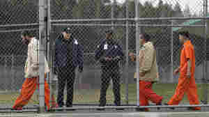 Inmates walk past correctional officers at the Washington Corrections Center in Shelton, Wash., on Feb. 17, 2011. Gov. Jay Inslee said last month that more than 3,000 prisoners in Washington have been mistakenly released early since 2002 because of an error by the state's Department of Corrections.