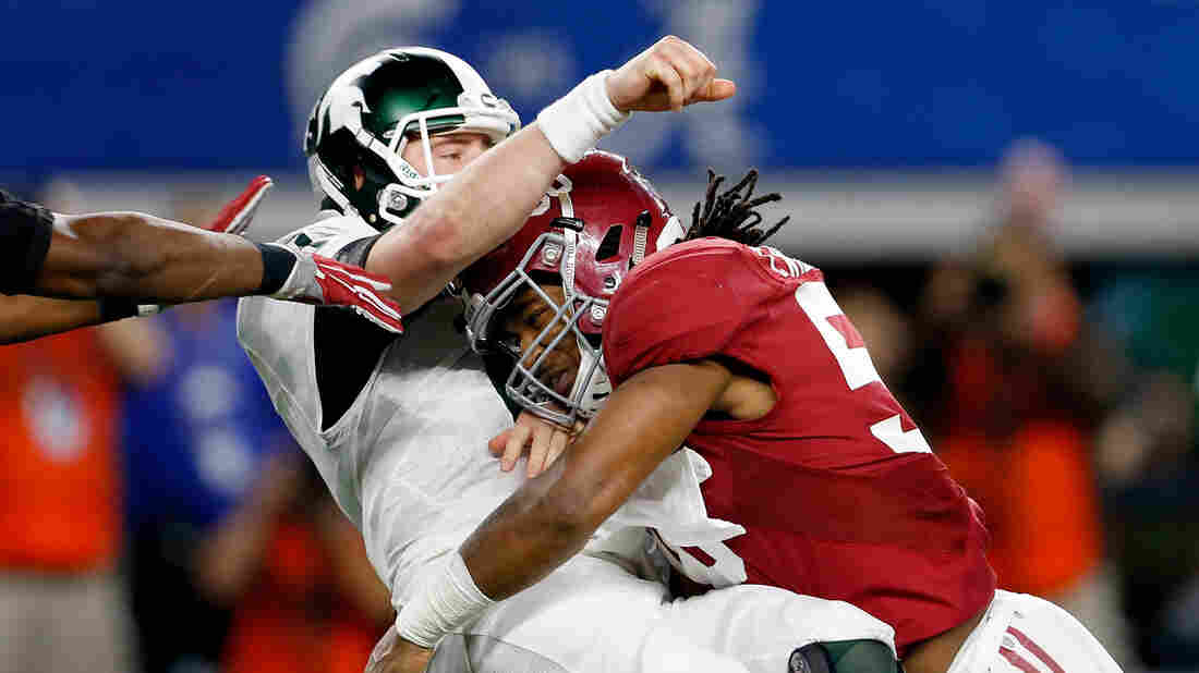 Tim Williams of the Alabama Crimson Tide sacks Connor Cook of the Michigan State Spartans in the second half Thursday during the Goodyear Cotton Bowl in Arlington, Texas. Williams threw two interceptions and the Spartans were unable to reach a single first down in the shutout loss.